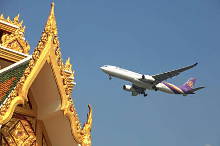 Bangkok Thailand 25 march 2017 : The Thai airways which boeing 777-300 was passing the temple and landing in Suwannabhum international airport.