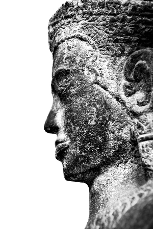 The face of the ancient Buddha on a white background inside the museum of Ayutthaya.