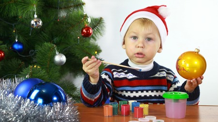boll: boy paints the Christmas boll