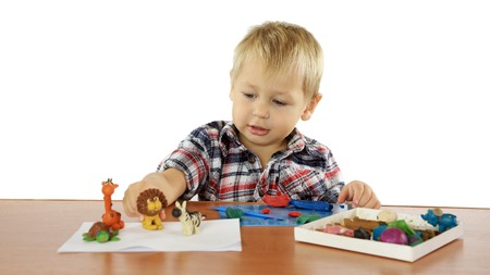 child's play clay: boy sculpts from plasticine animals
