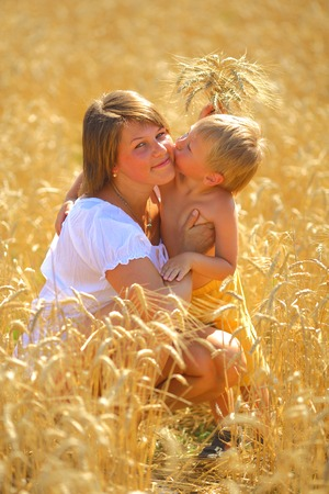 woman with  child in a wheat field photo
