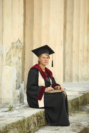 20 24 years old: woman scientist in ancient colonnade Stock Photo