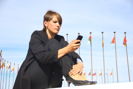 file clerk: business woman with a smartphone