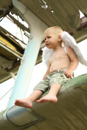 15 18: little boy with angel wings