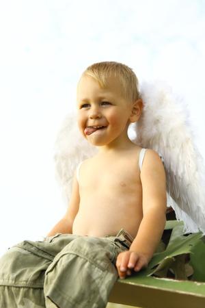 little boy with angel wings