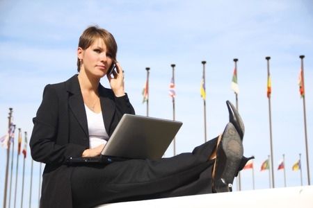 file clerk: Beautiful business woman with a laptop