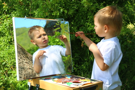 funny kid draws a picture on the mirror photo