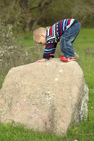 wins: funny kid wins his first top of the rock Stock Photo