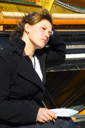 old piano: pensive woman at the old piano