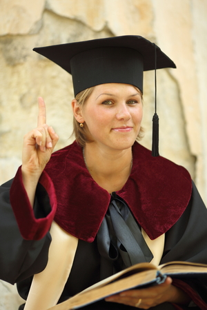 20 24 years old: graduate woman over vintage background Stock Photo