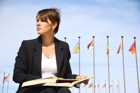 file clerk: businessman woman with books Stock Photo
