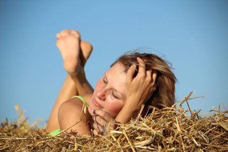 peasant: peasant girl resting in haystack Stock Photo
