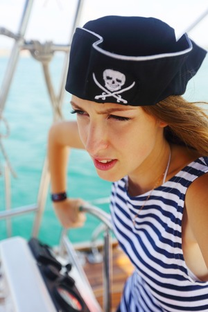 helm: beautiful pirate at the helm of a yacht Stock Photo