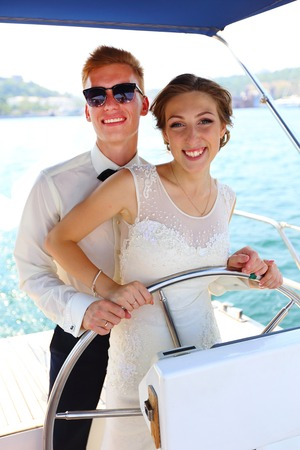cruise travel: Beautiful young couple on a honeymoon cruise on a yacht Stock Photo