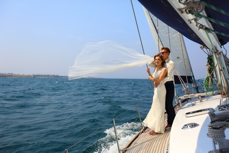 beautiful couple - bride and groom - a trip on a yacht