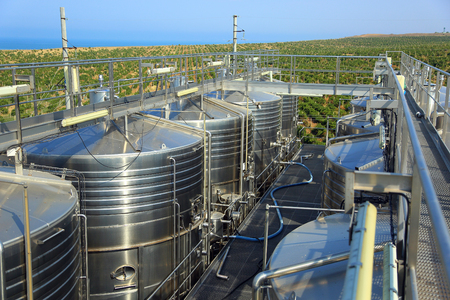 tanks of wine on a background of vineyards Stock Photo
