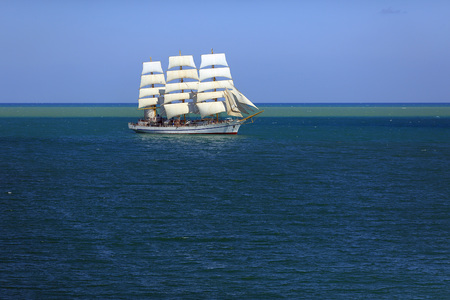 Old sailboat under all sails in the sea Stock Photo