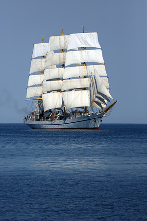tall ship with wind-filled sails in the sea