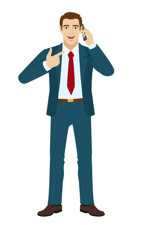 standing businessman: Businessman talking on the phone. Businessman pointing on the phone.