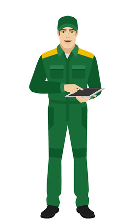 Man in uniform uses tabletdigital tablet PC. Full length portrait of Delivery man or Worker in a flat style. Vector illustration.