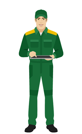 Man in uniform uses tabletdigital tablet PC. Full length portrait of Delivery man or Worker in a flat style. Vector illustration. Illustration