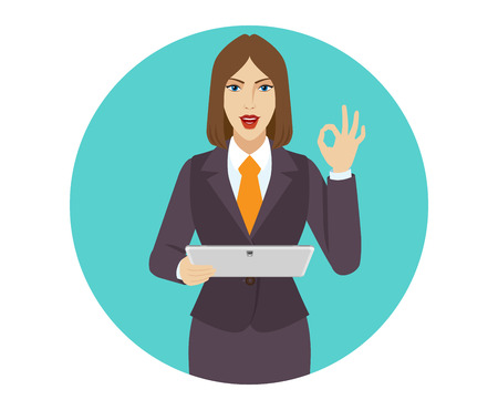 allright: Businesswoman holding a digital tablet and showing a okay hand sign.
