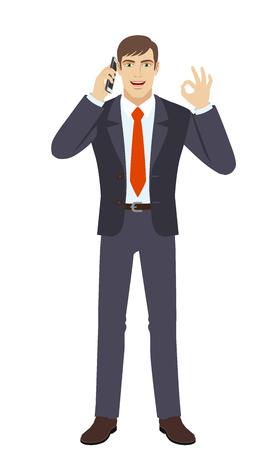 通信: OK! Businessman talking on the mobile phone and showing a okay hand sign. Full length portrait of businessman character in a flat style. Vector illustration.  イラスト・ベクター素材
