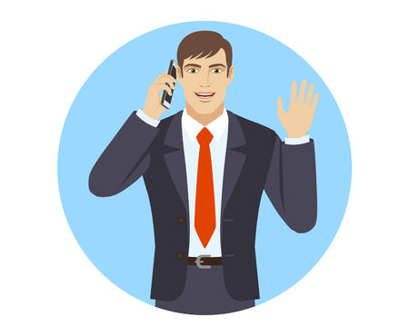 Businessman talking on the mobile phone and greeting someone with his hand raised up.