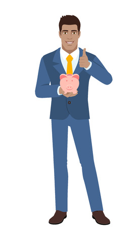 Businessman holding a piggy bank and showing thumb up.