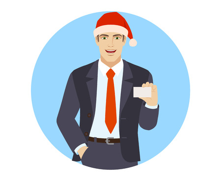 Businessman in Santa hat with hand in pocket showing the business card.