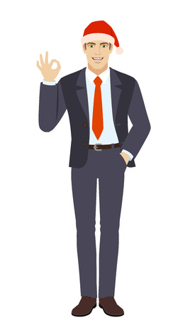 OK! Businessman in Santa hat showing a okay hand sign. Full length portrait of businessman in a flat style. Vector illustration. Çizim