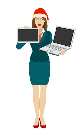 Businesswoman in Santa hat holding a laptop notebook and showing blank digital tablet PC. Full length portrait of businesswoman in a flat style. Vector illustration.
