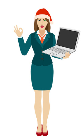 Businesswoman in Santa hat holding a laptop notebook and show a okay hand sign. Full length portrait of businesswoman in a flat style. Vector illustration.