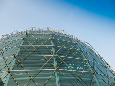dome building: Dome glass roof of Kingpower building on the Rangnam rd. There are metal golden frame. Stock Photo