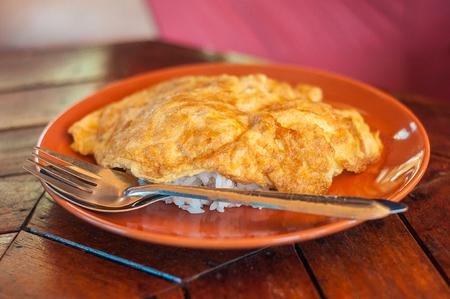 omlet: Thai-Style omlet on stream rice for breakfast on the morning