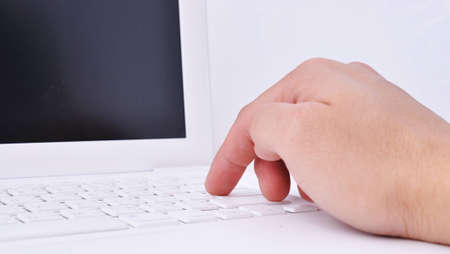 Close-up of man hand on the keyboard