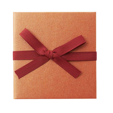 Single gold gift box with red ribbon on white background.