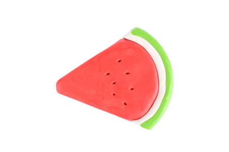 Slice of plasticine watermelon on a white background