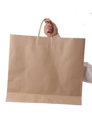 hand holding shopping bag, with space to your text or image isolated photo