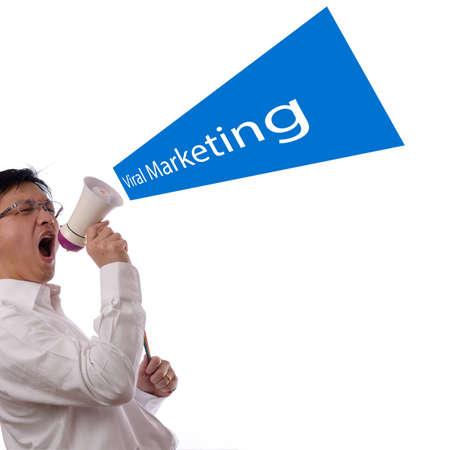 businessman using a megaphone: Portrait of an asian businessman using a megaphone for viral marketing design concept Stock Photo