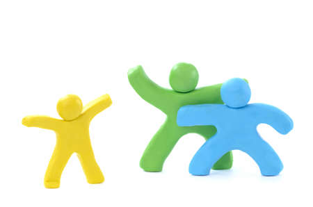 three color small plasticine people - the happy family  Stock Photo