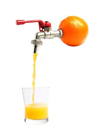 Fresh orange juice pouring straitght from the orange into a glass Stock Photo