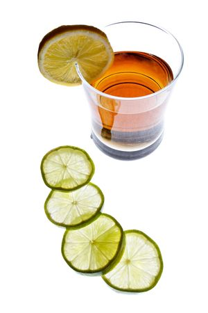 bartend: Bunch of lemon slices and backlit drink isolated on white             Stock Photo