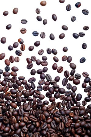 Falling fresh roasted coffee beans isolated on white background Stock Photo - 2910332