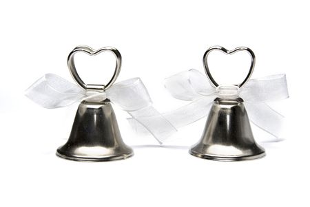 Two small wedding bells isolated on white background Stock Photo