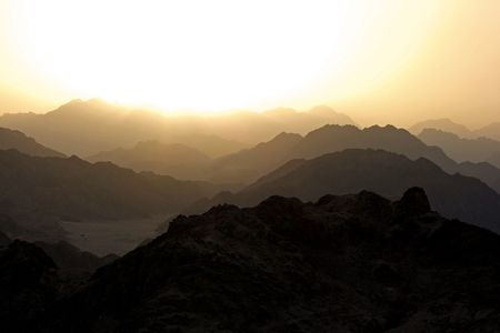 Golden silhouetted sunset in the mountains od Sinai