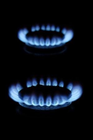 Blue gas flames burning on black background photo