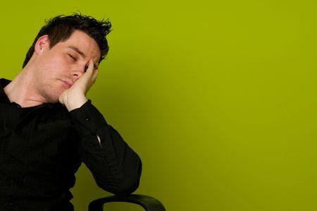 asleep chair: Young man in black shirt sleeping in chair