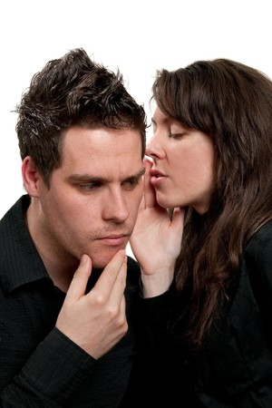 Young attractive girl whispering to a young man photo