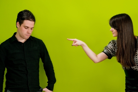 Girl pointing finger at man in accusing manner Stock Photo - 7082207